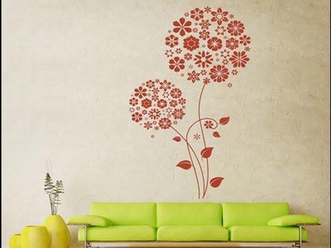 Нанесение рисунков на стены с помощью трафаретов
